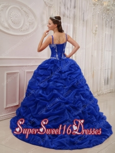 ball gown in royal blue with spaghetti straps court train